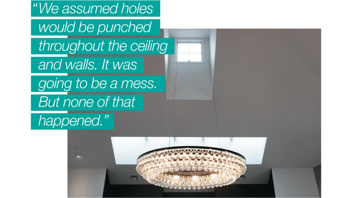 """An interior photo of PURE members Ron & Linda DeKoven's California home, with a quote overlaid that reads, """"We assumed holes would be punched throughout the ceiling and walls. It was going to be a mess. But none of that happened."""""""