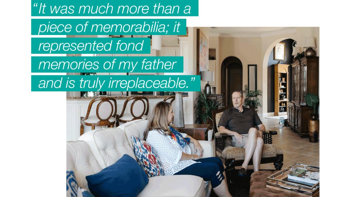 """A couple sitting in a large, comfortable living room overlaid with text that reads, """"It was much more than a piece of memorabilia; it represented fond memories of my father and is truly irreplaceable."""""""