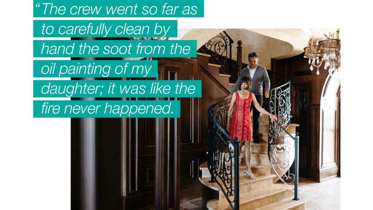 """A couple descending a marble staircase overlaid with text that reads, """"The crew went so far as to carefully clean by hand the soot from the oil painting of my daughter; it was like the fire never happened."""""""