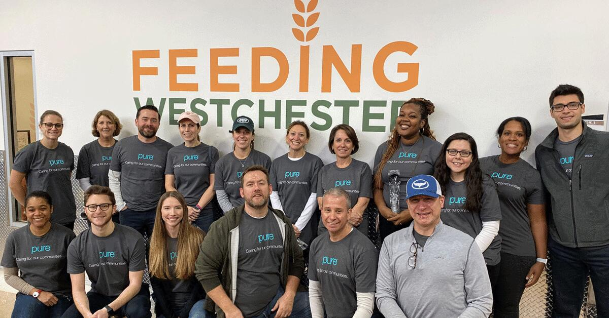 Group of PURE employees volunteering at Feeding Westchester